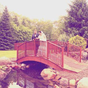 Couple posing on bridge